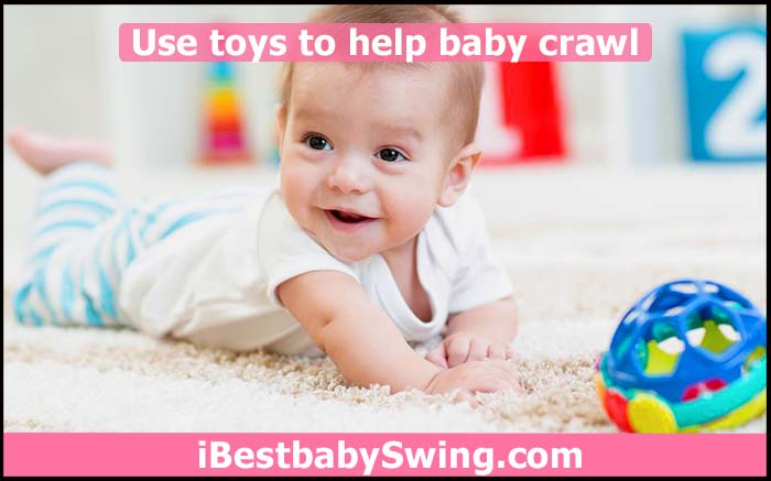 baby playing with toys to learn crawling