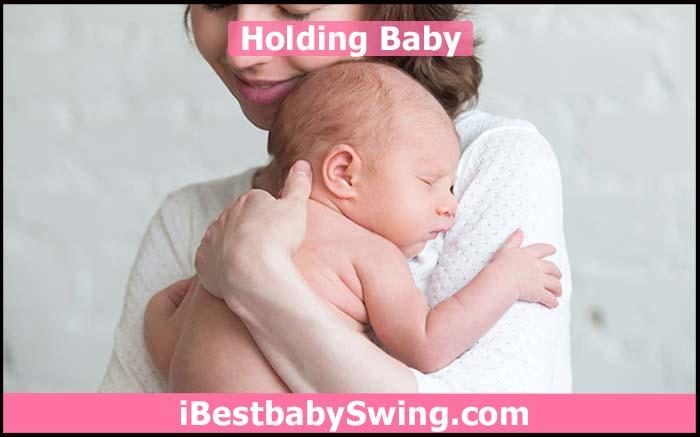 holding newborn baby