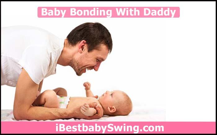 newborn baby bonding with daddy