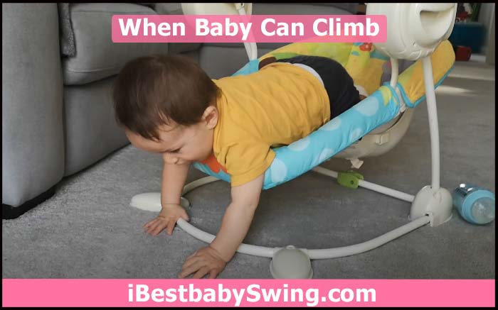 baby starts to climb out the swing