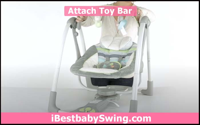 attach toy bar to assemble the upper part of ingenuity baby swing